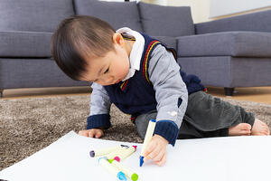 Asian baby kid drawing at home