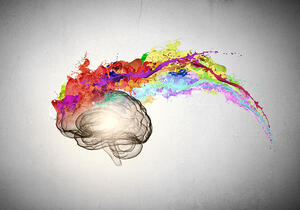 Conceptual image of human brain in colorful splashes