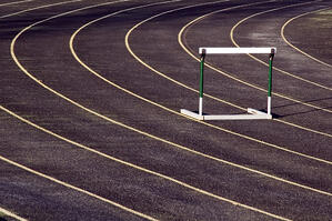 Lone hurdle on an outdoor track