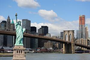 The landmark Statue of Liberty against the impressive New York City skyline.