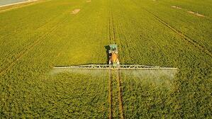 bigstock-Aerial-View-Tractor-Spraying-T-225500425