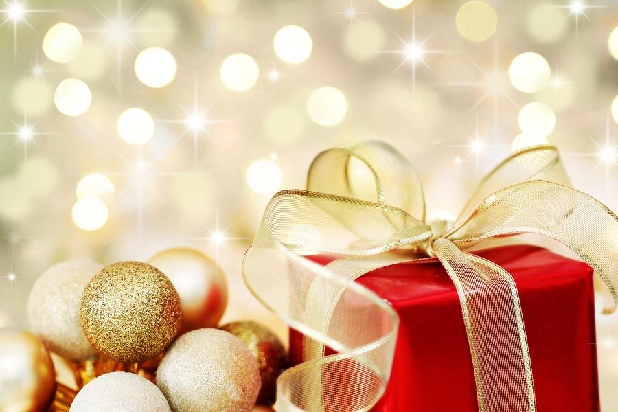 bigstock-Christmas-Gift-On-Defocused-Li-6064726.jpg
