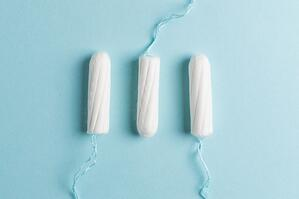 three tampons on blue background