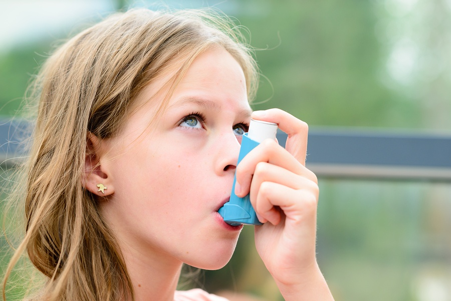 bigstock-Pretty-Girl-Using-Asthma-Inhal-119293265