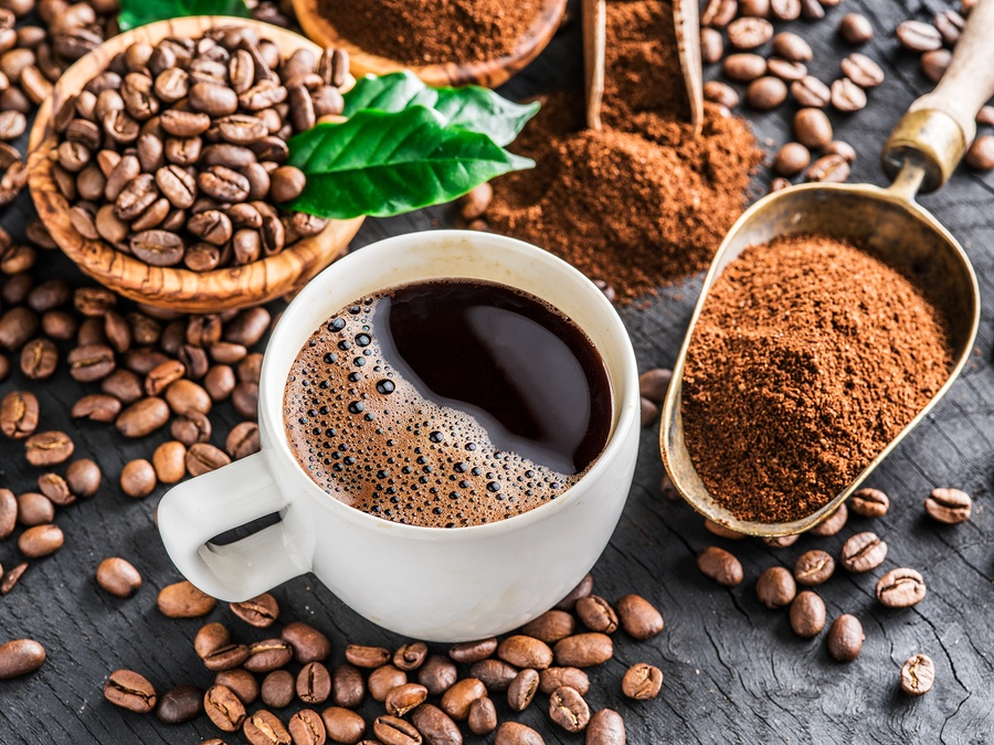 bigstock-Roasted-coffee-beans-ground-c-217339573