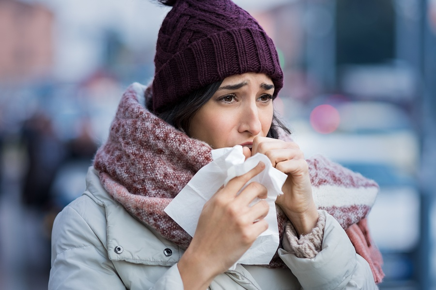 bigstock-Young-woman-coughing-during-wi-202277527.jpg